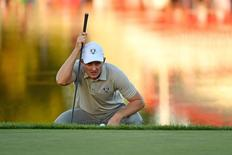 Justin Rose of England lines up a putt on the 17th green during the afternoon four-ball matches in the 41st Ryder Cup at Hazeltine National Golf Club. Mandatory Credit: John David Mercer-USA TODAY Sports