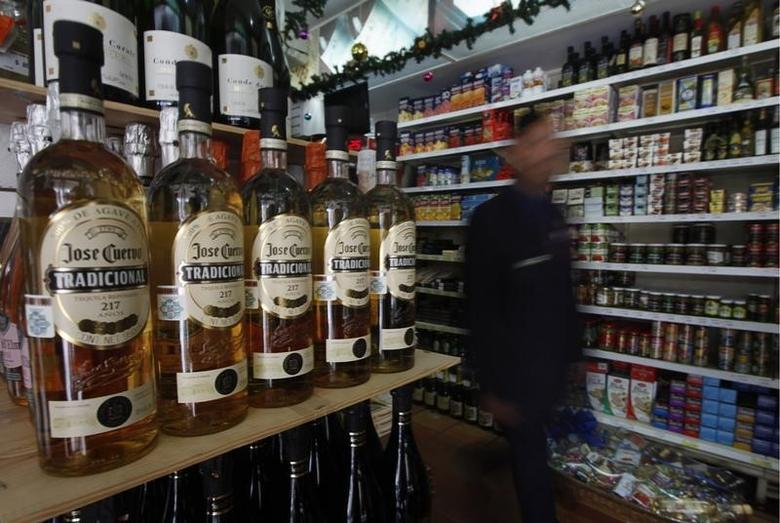 Bottles of Jose Cuervo Tequila rest on a shelf in Mexico City December 11, 2012.  REUTERS/Edgard Garrido