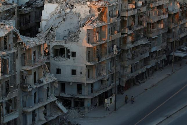 People walk past damaged buildings in the rebel-held Tariq al-Bab neighbourhood of Aleppo, Syria, October 5, 2016. REUTERS/Abdalrhman Ismail