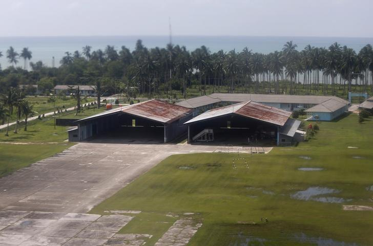 Two empty hangers stand near the beach at Ranai Airbase on Natuna Besar July 10, 2014. Picture taken July 10, 2014. REUTERS/Tim Wimborne/Files