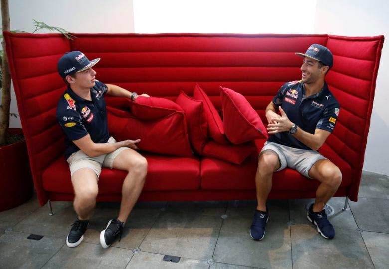 Red Bull Formula One driver Daniel Ricciardo (R) of Australia and Max Verstappen of the Netherlands pose for photo after they speak to the media in Tokyo, Japan ahead of weekend's Japanese F1 Grand Prix, October 5, 2016.    REUTERS/Toru Hanai