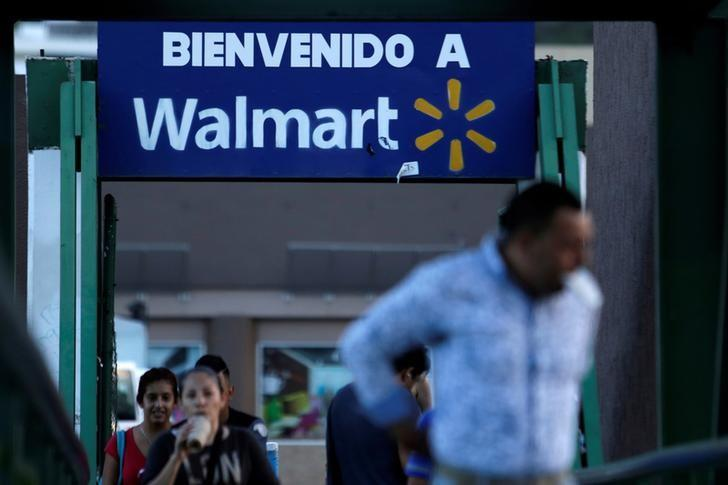 People passes by a sign welcoming to a Wal-Mart store in Monterrey, Mexico, August 10, 2016. REUTERS/Daniel Becerril/File Photo