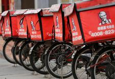 FILE PHOTO --  Logos of KFC, owned by Yum Brands Inc, are seen on its delivery bicycles in front of its restaurant in Beijing February 25, 2013.  REUTERS/Kim Kyung-Hoon/File Photo