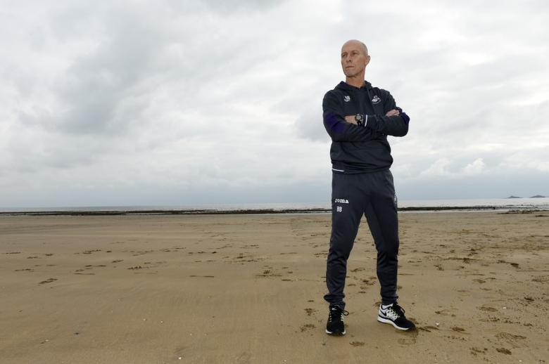Britain Soccer Football - Swansea City - Bob Bradley Press Conference - Marriott Hotel Swansea - 7/10/16Swansea City manager Bob Bradley poses after the press conferenceAction Images via Reuters / Tony O'Brien