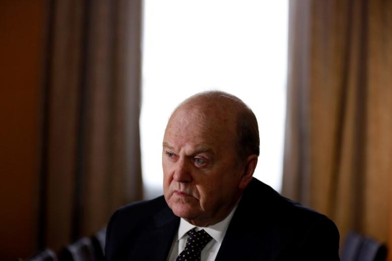 Ireland's Finance Minister Michael Noonan attends an interview with Reuters at his office in central Dublin February 11, 2014. REUTERS/Cathal McNaughton/File Photo