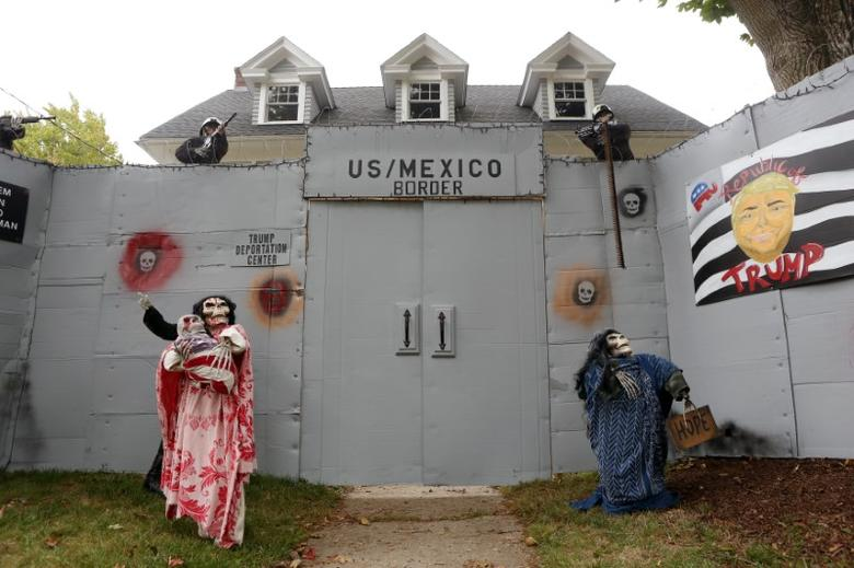 A Halloween display featuring a border wall and figures of Donald Trump, Hillary Clinton and Bernie Sanders is seen on the property of Matt Warshauer in West Hartford, Connecticut, U.S. October 4, 2016.  REUTERS/Michelle McLoughlin