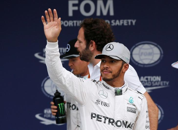 Formula One - Japanese Grand Prix - Suzuka Circuit, Japan - 8/10/16. Mercedes' Lewis Hamilton of Britain waves his hand after the qualifying session. REUTERS/Toru Hanai