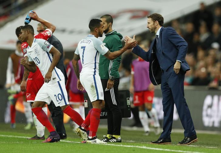 Football Soccer Britain - England v Malta - 2018 World Cup Qualifying European Zone - Group F - Wembley Stadium, London, England - 8/10/16England's Theo Walcott shakes hands with England interim manager Gareth Southgate as he is substituted Action Images via Reuters / John SibleyLivepic