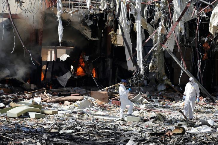 Forensic experts investigate the scene at the community hall where Saudi-led warplanes struck a funeral in Sanaa, the capital of Yemen, October 9, 2016. REUTERS/Khaled Abdullah