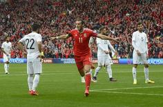 Football Soccer Britain - Wales v Georgia - 2018 World Cup Qualifying European Zone - Group D - Cardiff City Stadium, Cardiff, Wales - 9/10/16. Wales' Gareth Bale celebrates scoring their first goal. Reuters / Rebecca Naden