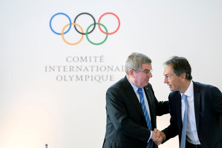 International Olympic Committee (IOC) President Thomas Bach (L) shakes hands to IOC Director General, Christophe De Kepper at the opening of an Olympic Summit on reforming the anti-doping system on October 8, 2016 in Lausanne. REUTERS/Fabrice Coffrini/Pool