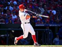 Oct 9, 2016; Washington, DC, USA; Washington Nationals catcher Jose Lobaton (59) hits a three run home run against the Los Angeles Dodgers during the fourth inning during game two of the 2016 NLDS playoff baseball series at Nationals Park. Mandatory Credit: Brad Mills-USA TODAY Sports