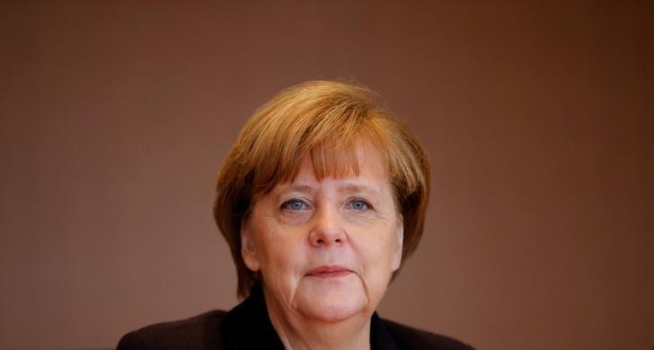 German Chancellor Angela Merkel attends the weekly cabinet meeting at the Chancellery in Berlin, Germany December 1, 2015. REUTERS/Fabrizio Bensch/File Photo