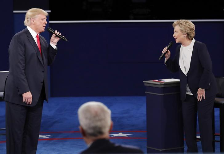 Republican U.S. presidential nominee Donald Trump and Democratic U.S. presidential nominee Hillary Clinton speak during their presidential town hall debate at Washington University in St. Louis, Missouri, U.S., October 9, 2016.    REUTERS/Jim Young