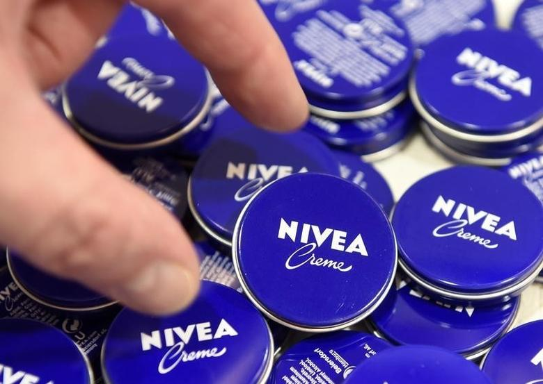 A shareholder of German care cosmetic company Beiersdorf, picks up a Nivea tin before the start of the shareholder meeting in Hamburg, March 31, 2016. REUTERS/Fabian Bimmer