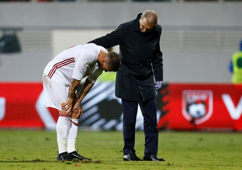 Football Soccer - Albania v Spain - World Cup 2018 Qualifiers - Loro Borici Stadium, Shkoder, Albania -9/10/16. Spain's Sergio Ramos reacts after an injury. REUTERS/Antonio Bronic