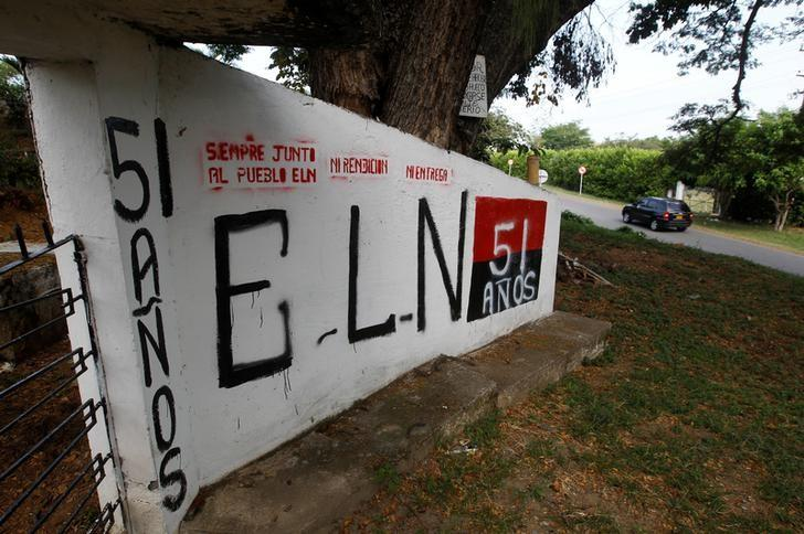 A graffiti, of rebel group Army Liberation National (ELN) is seen at the entrance of the cemetery of El Palo, Cauca, Colombia, February 10, 2016. REUTERS/Jaime Saldarriaga