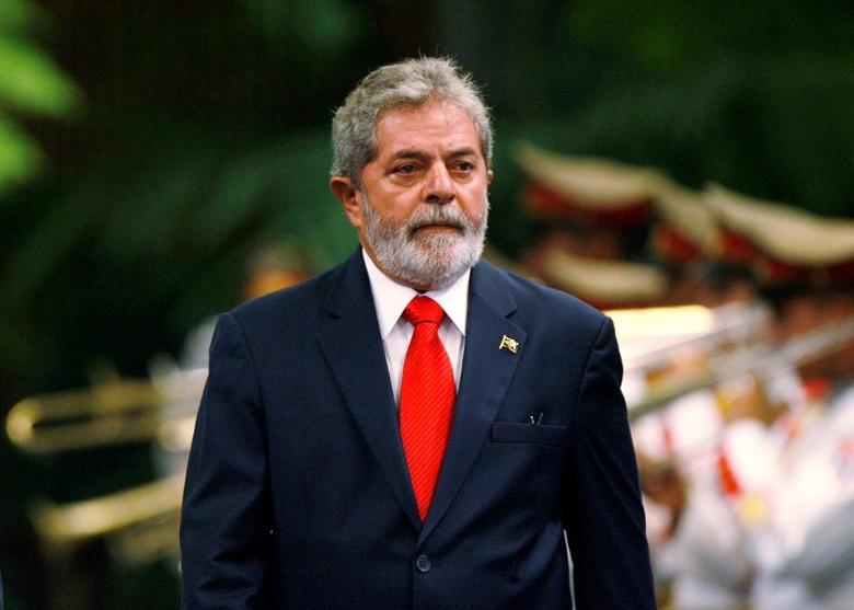 File photo: Brazil's President Luiz Inacio Lula da Silva reviews the honor guard during a reception ceremony at Havana's Revolution Palace January 15, 2008. REUTERS/Claudia Daut/File Photo