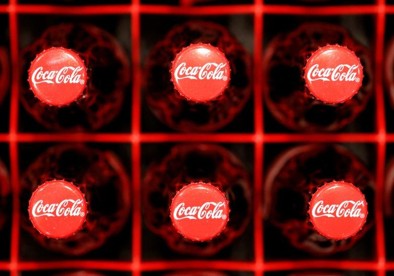 Logos are seen on Coca-Cola bottles in Zurich, February 16, 2011. REUTERS/Christian Hartmann/File Photo