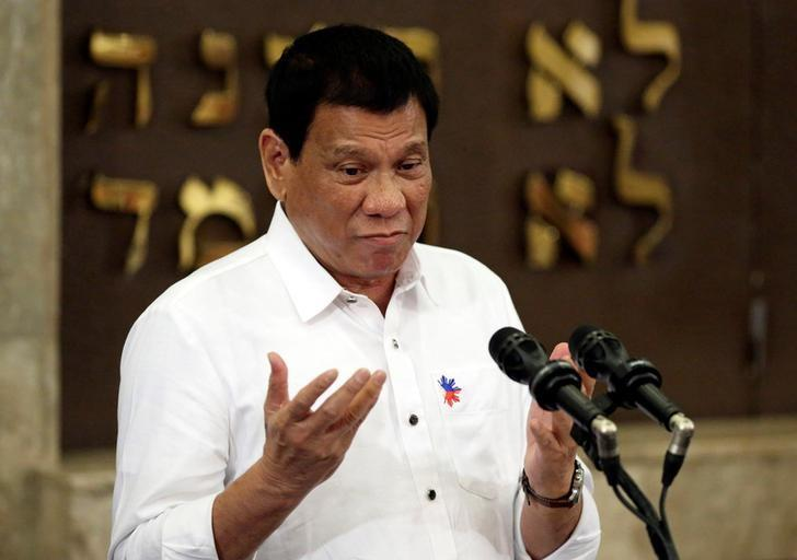Philippine President Rodrigo Duterte gestures during his speech at the Beit Yaacov Synagogue, The Jewish Association of the Philippines in Makati city, metro Manila, Philippines October 4, 2016. REUTERS/Aaron Favila/Pool/Files