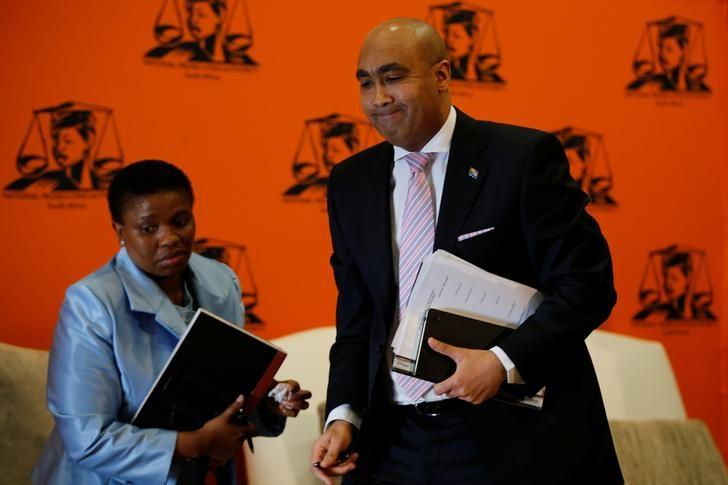National Director of Public Prosecutions Shaun Abrahams (R) walks past his deputy Adv Nomgcobo Jiba as he leaves at the end of a media  briefing in Pretoria, South Africa, May 23, 2016. REUTERS/Siphiwe Sibeko /Files