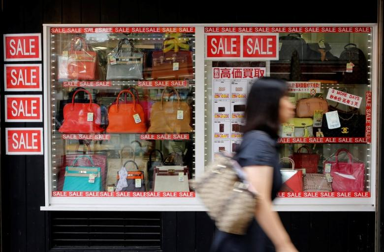 A woman walks past a luxury boutique in a shopping district in Tokyo, Japan, September 29, 2016.  REUTERS/Toru Hanai