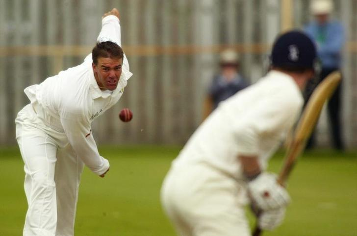 Zimbabwe's Heath Streak lines up a bowl during their one daymatch against Ireland at Eglinton Cricket Club, Londonderry, NorthernIreland, June 15, 2003. REUTERS/Paul McErlane/Files