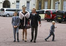 Singer Rod Stewart arrives at Buckingham Palace with his wife, Penny Lancaster and children Alastair and Aiden, to receive a knighthood, in London, Britain, October 11, 2016. REUTERS/Gareth Fulller/Pool
