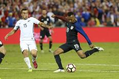Oct 11, 2016; Washington, D.C., USA; United States forward Julian Green (19) shoots the ball as New Zealand midfielder Clayton Lewis (15) defends in the second half at RFK Stadium. Mandatory Credit: Geoff Burke-USA TODAY Sports