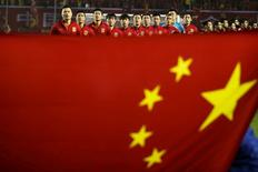 Football Soccer - China v Syria - 2018 World Cup Qualifying Asia Zone - Round 3 Group A - Xi'an, China - 6/10/16 - Team China listen to national anthem behind a Chinese national flag ahead of the match. REUTERS/Stringer/File Photo