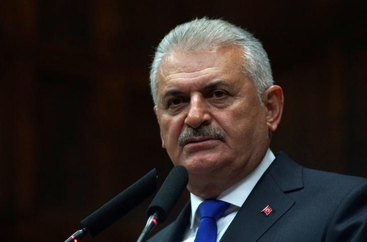 Turkey's Prime Minister Binali Yildirim addresses members of parliament from his ruling AK Party (AKP) during a meeting at the Turkish parliament in Ankara, Turkey, October 4, 2016. REUTERS/Umit Bektas