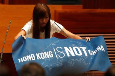 Hong Kong lawmakers defy Beijing