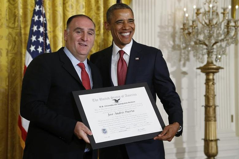 U.S. President Barack Obama (R) honors Spanish-born chef and restauranteur Jose Andres with the Outstanding American by Choice award during a naturalization ceremony at the White House in Washington July 4, 2014.    REUTERS/Jonathan Ernst/File Photo