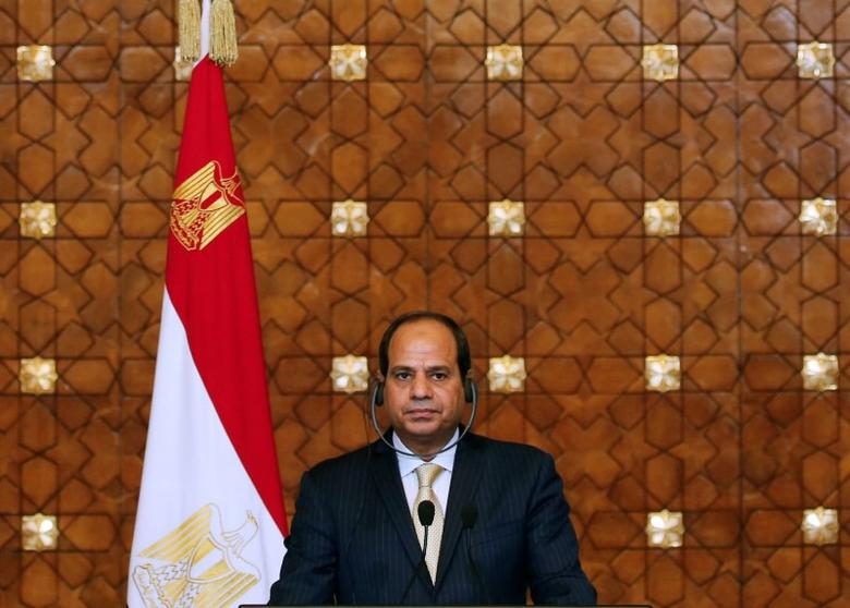 Egypt's President Abdel Fattah al-Sisi attends a news conference with Greek Prime Minister Alexis Tsipras and the Cyprus' President Nicos Anastasiades (unseen) at the El-Thadiya presidential palace in Cairo, Egypt, October 11, 2016. Picture taken October 11, 2016. REUTERS/Amr Abdallah Dalsh
