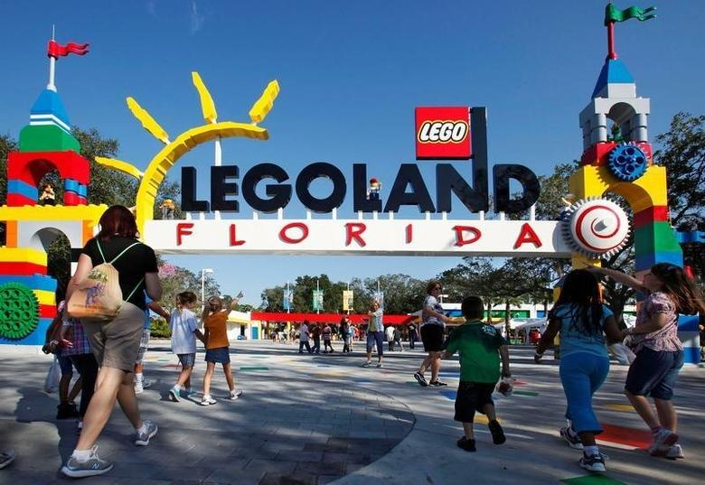FILE PHOTO - Park visitors enter Legoland Florida during its grand opening celebration in Winter Haven, Florida October 14, 2011.  REUTERS/Pierre DuCharme/File Photo