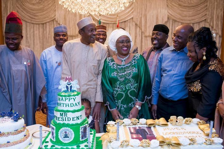 Nigeria's President Muhammadu Buhari (3rd L) and his wife Aisha Buhari pose with guests during the president's birthday celebration in Abuja, Nigeria December 16, 2015. REUTERS/Stringer/File Photo