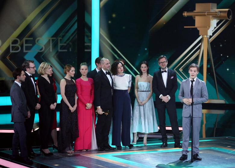 The cast of 'Deutschland 83' accepts the award for Best German Mini-series during 'Die Goldene Kamera' (Golden Camera) awards ceremony in Hamburg, Germany, February 6, 2016.  REUTERS/Christian Charisius/Pool/File Photo