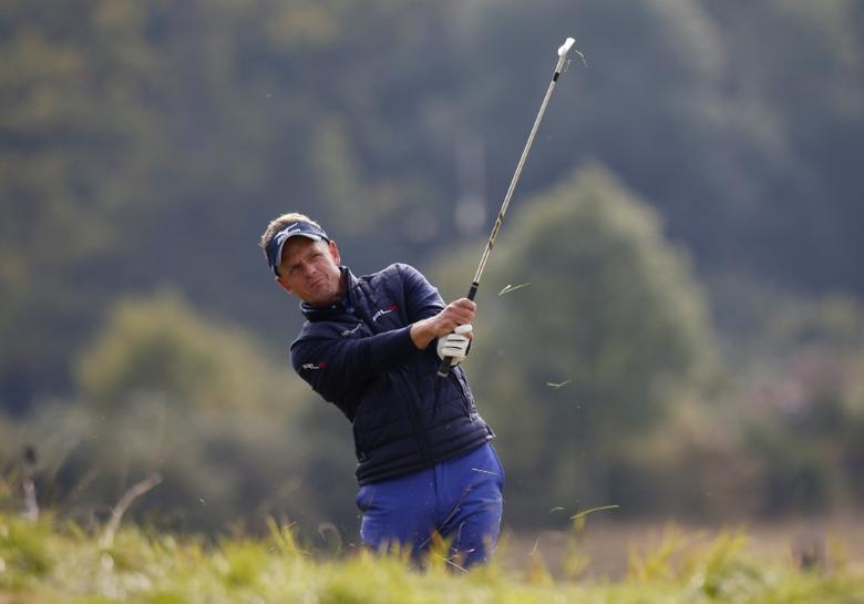 Britain Golf - British Masters - The Grove, Hertfordshire - 14/10/16England's Luke Donald plays his second shot out of the rough at the 9th hole during the second roundAction Images via Reuters / Paul Childs