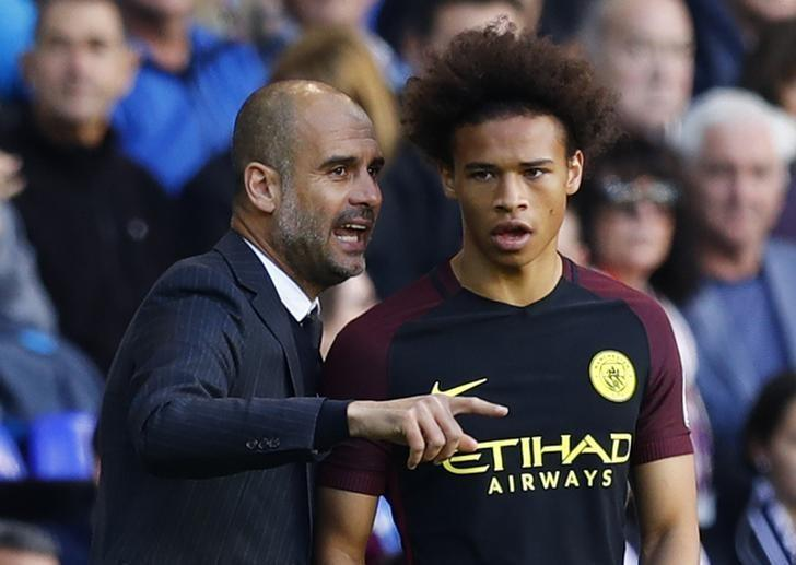 Britain Soccer Football - Tottenham Hotspur v Manchester City - Premier League - White Hart Lane - 2/10/16Manchester City's Leroy Sane speak with manager Pep Guardiola as he prepares to come on as substituteReuters / Eddie KeoghLivepicEDITORIAL USE ONLY.