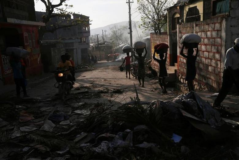 A view of traffic and people walking along a street after Hurricane Matthew hit Jeremie, Haiti. REUTERS/Carlos Garcia Rawlins