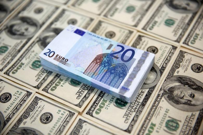 U.S. dollar and euro banknotes are seen in this picture illustration, March 9, 2015. REUTERS/Dado Ruvic/Illustration/File Photo