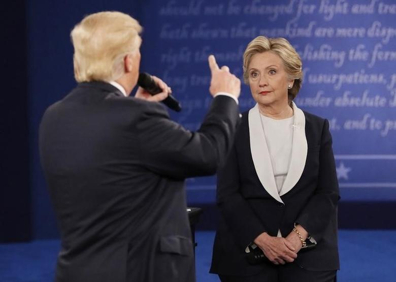 Republican U.S. presidential nominee Donald Trump speaks during the presidential town hall debate with Democratic U.S. presidential nominee Hillary Clinton at Washington University in St. Louis, Missouri, U.S., October 9, 2016.  REUTERS/Shannon Stapleton
