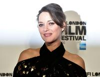 """Marion Cotillard poses as she arrives for the gala screening of the film """"Its only the end of the world"""" , during the 60th British Film Institute (BFI) London Film Festival at Leicester Square in London, Britain October 14, 2016. REUTERS/Hannah McKay"""