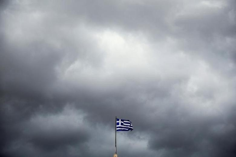 A Greek national flag flutters atop the Athens University, Greece, May 5, 2016. REUTERS/Alkis Konstantinidis/File Photo