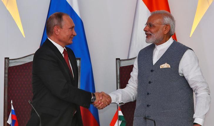 Russian President Vladimir Putin (L) shakes hands with India's Prime Minister Narendra Modi during exchange of agreements event after India-Russia Annual Summit in Benaulim, in the western state of Goa, India, October 15, 2016. REUTERS/Danish Siddiqui
