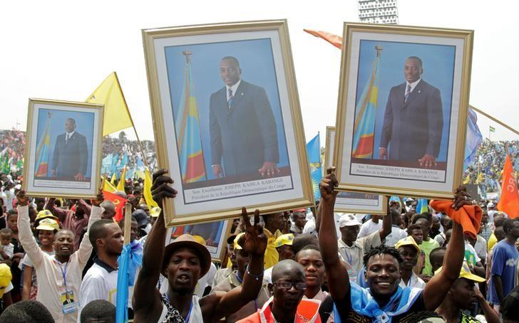 Supporters of Congolese President Joseph Kabila carry his portrait photographs during a pro-government rally in the Democratic Republic of Congo's capital Kinshasa  July 29, 2016. REUTERS/Kenny Katombe/File Photo
