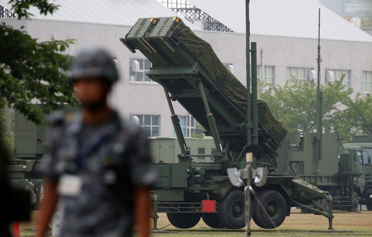 A Japan Self-Defense Forces soldier guards near a unit of Patriot Advanced Capability-3 (PAC-3) missiles at the Defense Ministry in Tokyo, Japan June 22, 2016.    REUTERS/Toru Hanai/Files