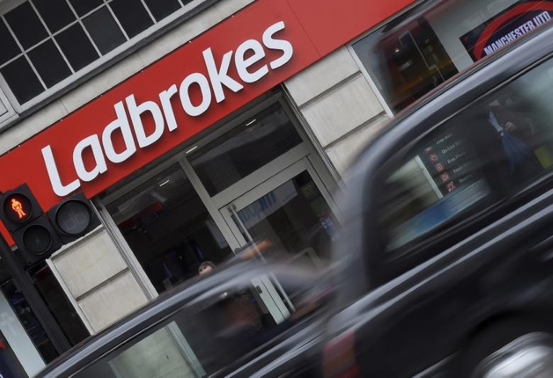 A taxi passes a branch of Ladbrokes in central London, Britain, May 17, 2016. REUTERS/Toby Melville