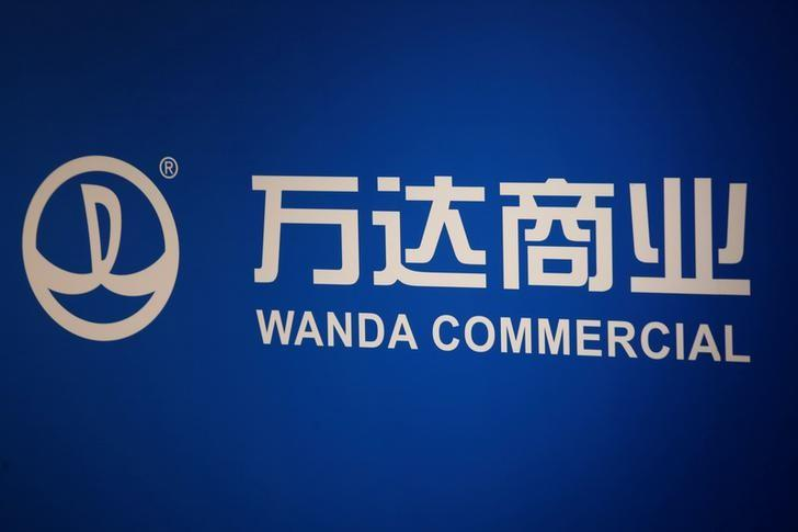 The company logo of Dalian Wanda Commercial Properties Co Ltd is displayed at a news conference on the company's annual results in Hong Kong, China March 24, 2016.  REUTERS/Bobby Yip/File Photo