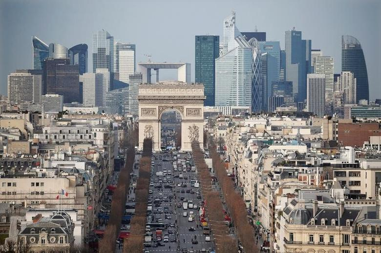 General view of the skyline of La Defense business district with its Arche behind Paris' landmark, the Arc de Triomphe and the Champs Elysees Avenue in Paris, France, January 13, 2016.  REUTERS/Charles Platiau/File Photo  - RTX2MNO9